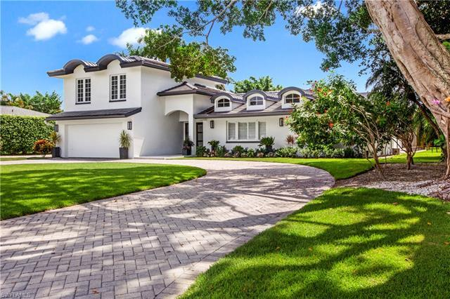 Beautiful two-story home, with southern exposure, located in one of Naples most sought-after neighbo