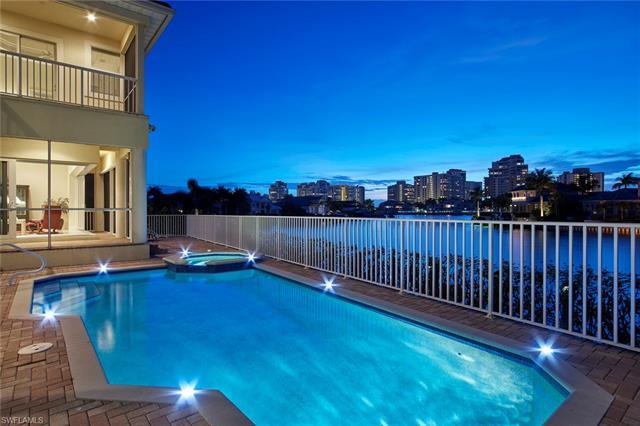 Delight in panoramic water views from numerous vantage points in this palatial Park Shore home. The
