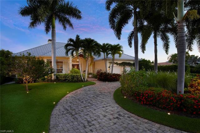 One level living at its finest in this old Florida style dream. A charming covered front porch, meta