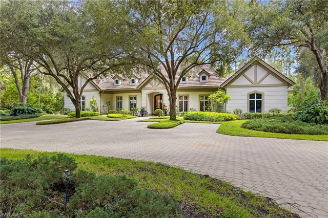 VIEW THE 3D TOUR! Pulling into the grand entrance of this custom built home on 4.67 acres you will n