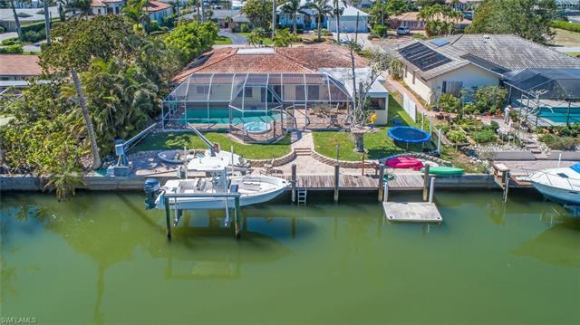 Direct Gulf access home with boat dock and lift. Pool and spa have desired SE exposure. Just a few m