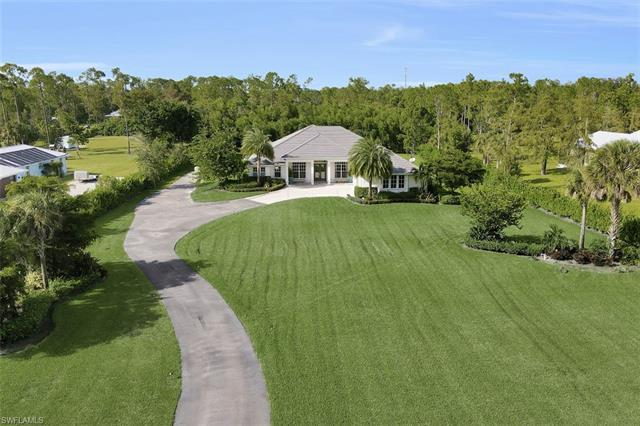 Rarely available 2.73 Acre Lot with a better than new, 2015, Designer Customized home. Custom local