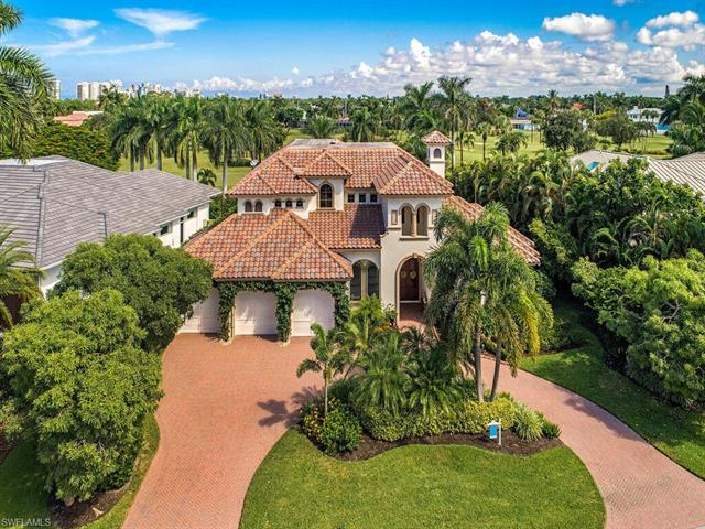Magnificent custom built home on the Moorings Country Club golf course! Enjoy the open lanai area wi