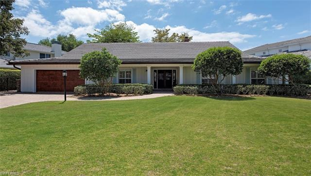 Meticulously maintained one story - ranch style home - located on one of the most beautiful streets