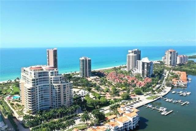 LUXURY BEACHFRONT TOWER...LOCATED IN EXCLUSIVE PARK SHORE...A GRAND STAIRCASE/ELEVATOR LEADS YOU TO