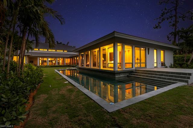 Contemporary home located in the luxury community of Quail West County Club. Western exposure with l