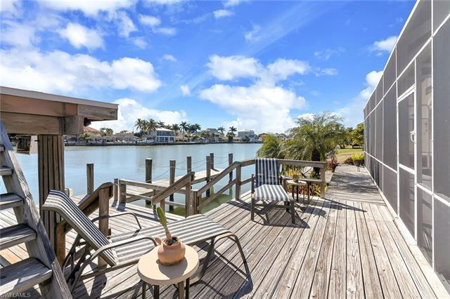 Perfectly nestled along the crystal bay waters that make up Isles of Capri, comes a remarkable singl