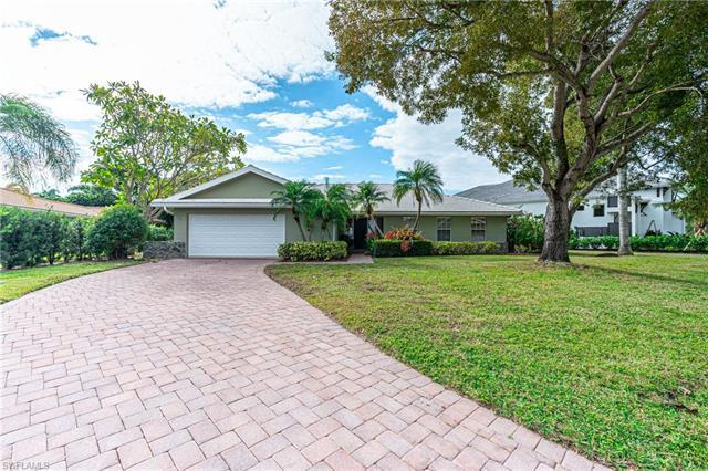Located on a quiet street West of 41 in the highly sought after Park Shore community, this charming