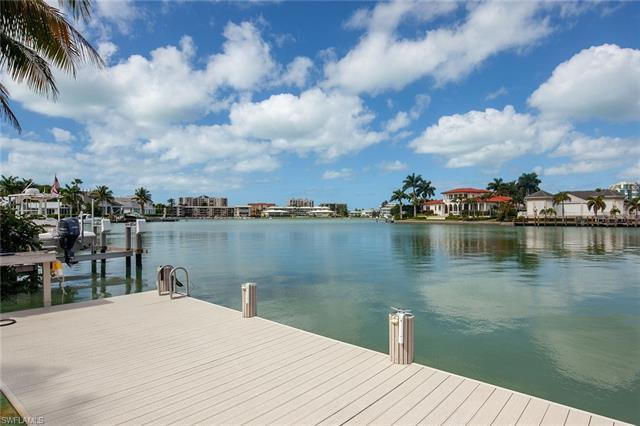 Stunning bay and sunset views await you from this fully remastered waterfront home located on one of