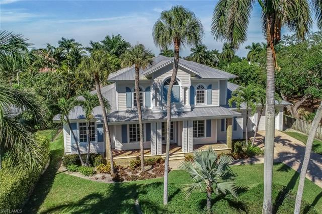 Rare find west of Crayton Road on a quiet street in the heart of the Moorings.  Enjoy the casual ele