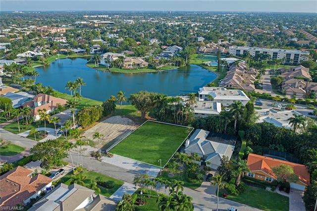 Located in desirable Park Shore on one of the last remaining lake view lots, built by Lexa Homes and