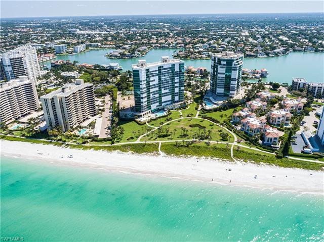 Panoramic views of the Gulf of Mexico await you - probably not for long! - at this spacious end unit