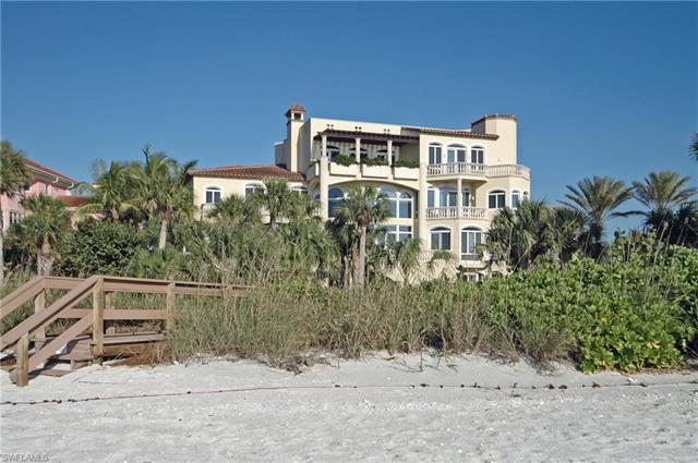 One of 12 residences in a gated beachfront enclave featuring an extraordinary 9,037 Sq. Ft. home tha