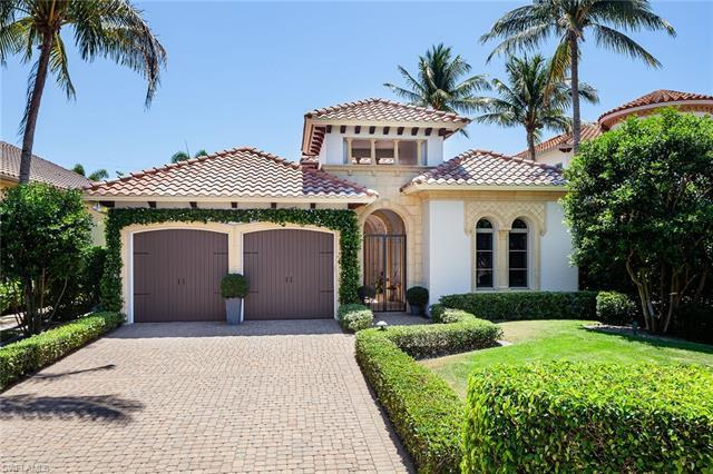 Tucked away on Fairway Terrace, this spectacular residence offers classic architecture, with courtya