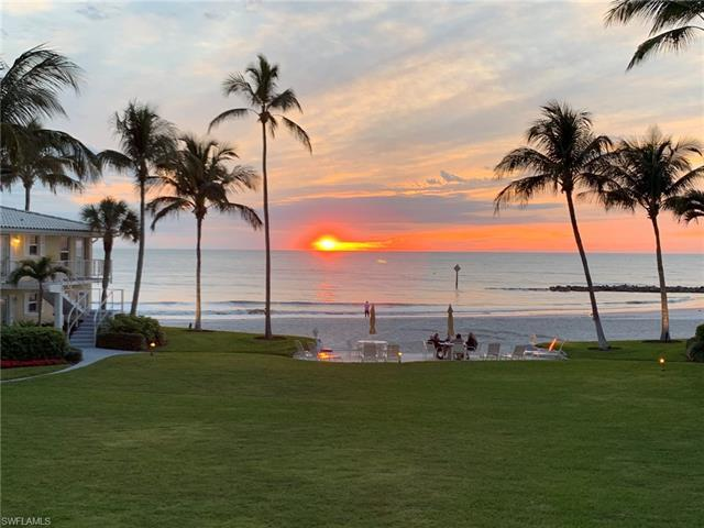 Enjoy daily unobstructed sunset and beachfront views from this fully remodeled two-bedroom, two-bath