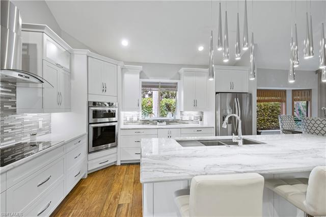 Beautifully updated Pelican Bay home on a quiet cul-de-sac and in very close proximity to Artis-Napl