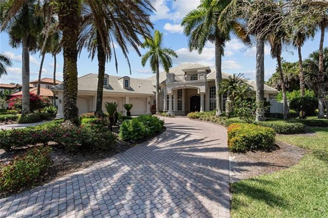 Welcome to 8699 Purslane Drive, nestled within the pristine secure gated surroundings of Bay Laurel