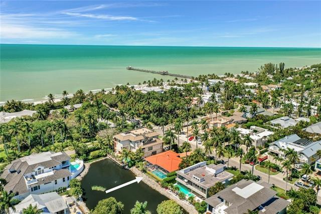 It's not often you find a lakefront home with desirable southern exposure located only one block to
