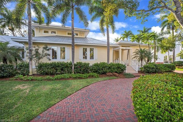 Like new, coastal home in sought-after Olde Naples. Discover luxurious living at this one-of-a-kind