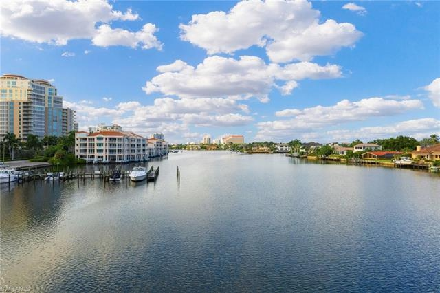 Spectacular Park Shore condominium with long water Bay and City views. Well-conceived and rarely ava