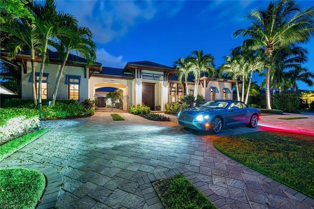 H3621 Stunning gated enclave. Coveted 1/2-acre lot in The Moorings. Exquisite 4-bedroom, den, 4 bath