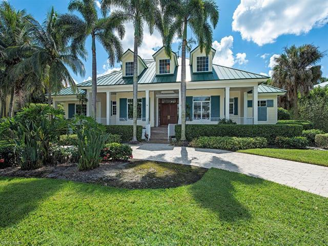 Only four houses from Naples pristine beaches, this home represents the quintessential tropical retr