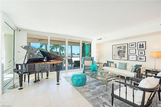 Tropical, lush landscaping greets you from the moment you enter this light-filled third floor reside