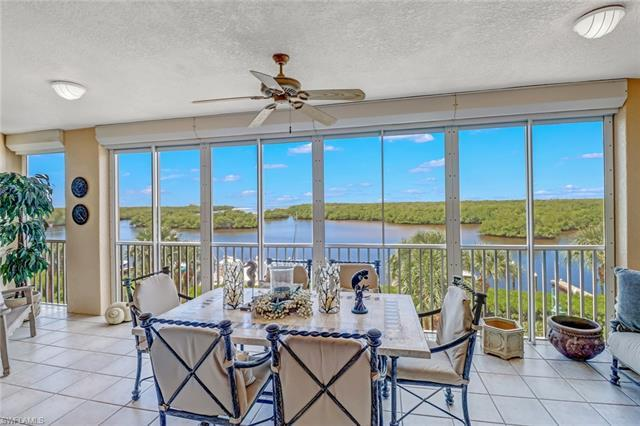NEW LISTING at Pelican Isle Yacht Club! Beautiful Wiggins Pass & Gulf of Mexico views from 402 in WE