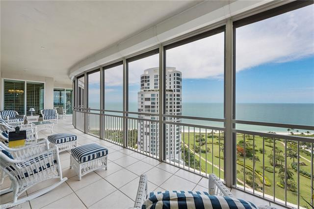 On the beach in the heart of Park Shore, magnificent Gulf and northern Bay views await you in this h