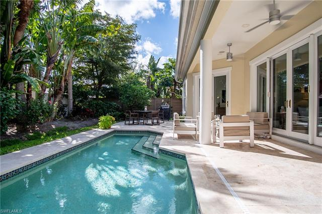 Seldom available, this beautiful home in The Mews of Naples is part of the exclusive enclave of thir