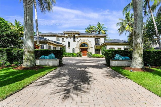Sophisticated and luxurious estate home in the prestigious Bay Colony Golf Club Estates, a gated enc