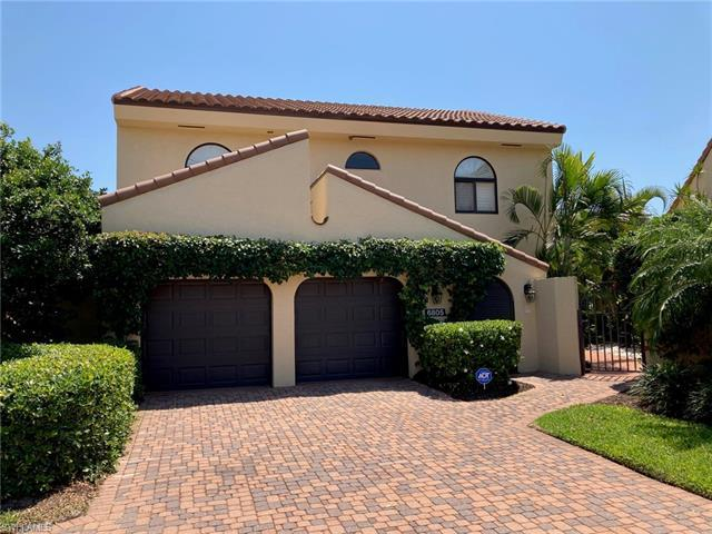 H 2306  Rare villa opportunity in sought-after Pelican Bay. This two-story home features a ground-fl