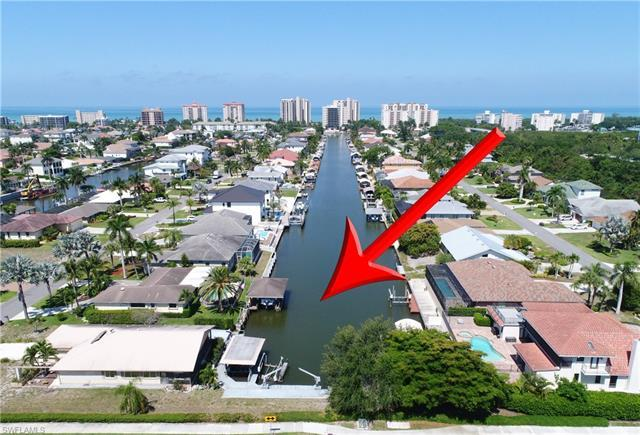 This Connors Vanderbilt Beach property sits on a much larger canal lot (12,479 sq ft) than the typic