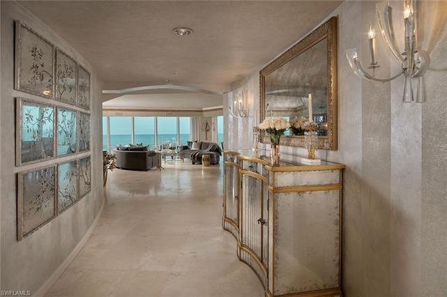 Serene & sophisticated, this beachfront sky home is stunningly updated with shimmering finishes & lu