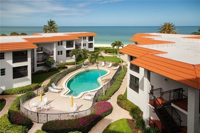 Rare opportunity on the beach in the Moorings. Exceptionally well-maintained end unit, 3-bedroom, 3-