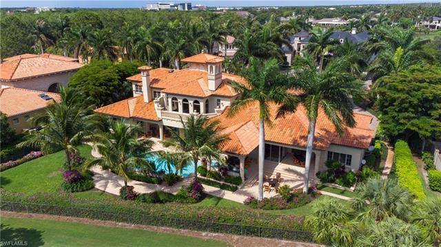 This vibrant and luxurious estate home in the very private Estates at Bay Colony Golf Club is nestle