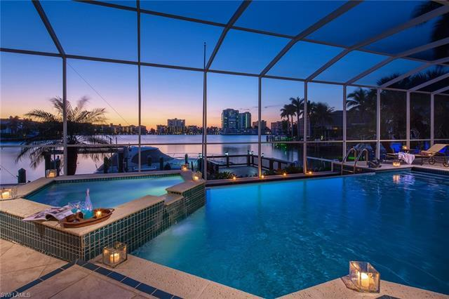 Long, wide water bay views are the focal point of this sprawling one-level home on Moorings Bay.  Fe