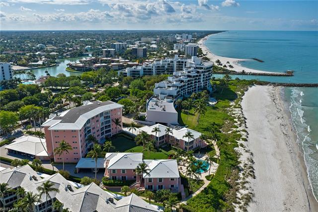 Stunning beach front views await! This two bedroom, two-bath, third-floor unit at The Shores of Napl