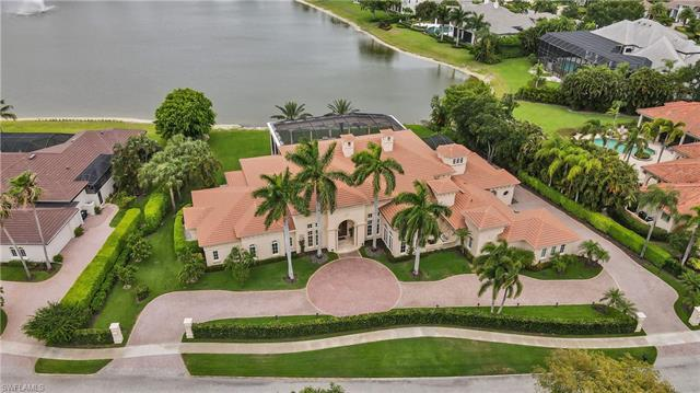 This Mediterranean style grande estate home has a sensational 11-acre lake view! Master suite provid