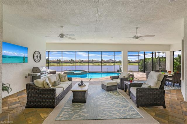 Calling all lakefront home buyers in North Naples! Sited on a premium lot with 180-degree water view