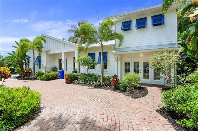 Located in the heart of Old Naples, this meticulously renovated Old Florida home is a short walk to