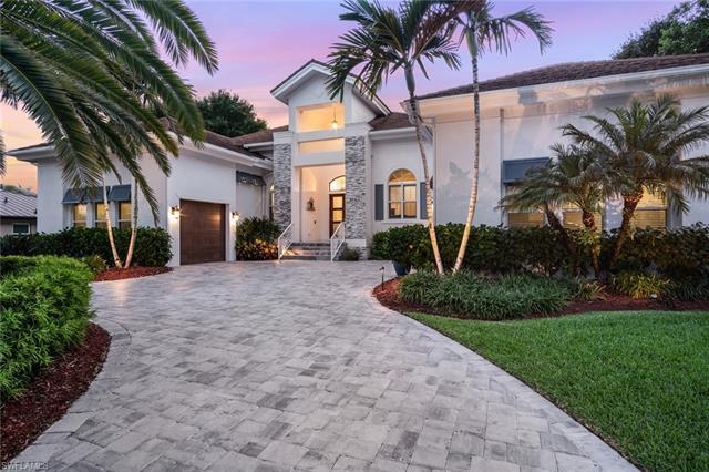 An exceptional home located in one of the most prestigious streets in Park Shore! Just a few steps a
