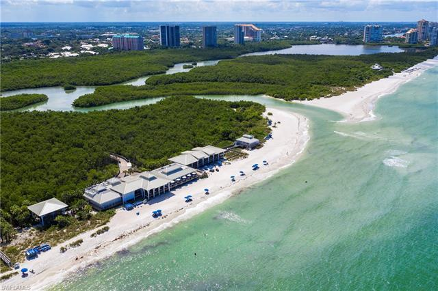 C2847 Sweeping Gulf, bay and city views make this unique Heron 601 condo in Pelican Bay a desired re