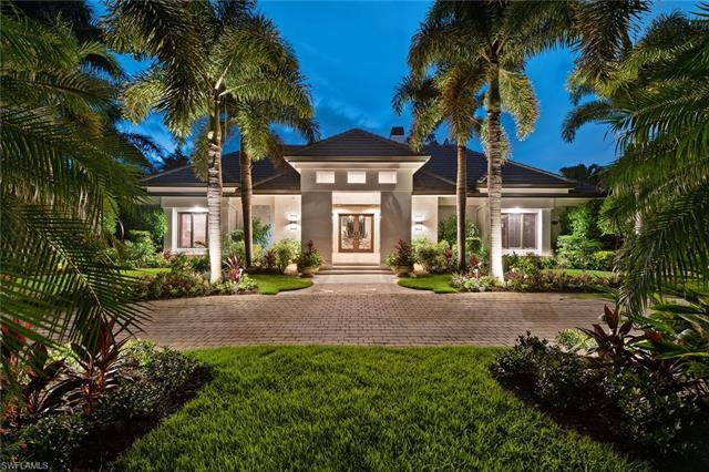 Live the Naples lifestyle in the desirable beach community of Pelican Bay. Situated on a half acre p