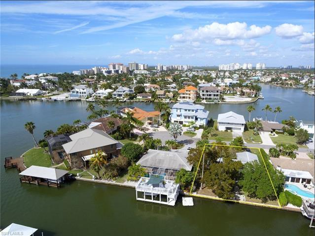 Exceptional south facing waterfront building site in Conners Vanderbilt Beach Estates. This property