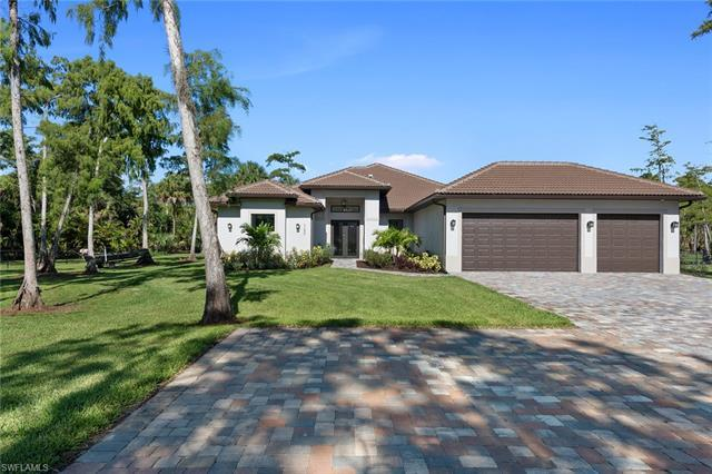 Live the Naples lifestyle in the desirable community of Golden Gate Estates. Situated on a 2.82-acre