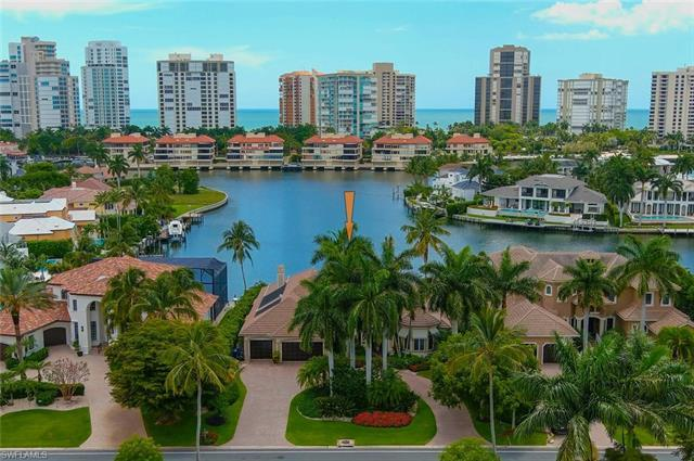 Luxury WATERFRONT living awaits you in beautifully appointed custom home in the heart of Naples. The