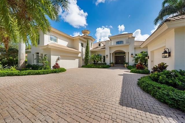 Picturesque lakefront and golf course views from meticulously maintained custom home with 5360 sf li