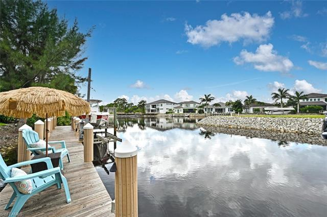 RARELY AVAILABLE!! Don't miss this custom waterfront estate home nestled in this best kept secret, h