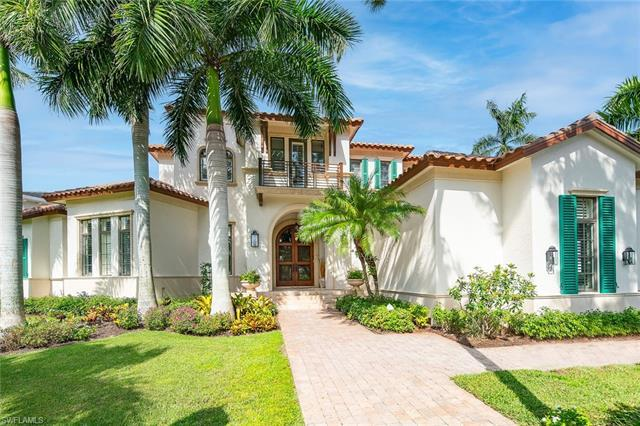 This meticulously maintained waterfront home on a corner lot in the prestigious Royal Harbor neighbo